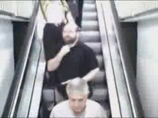 Woman Falling Down Escalator
