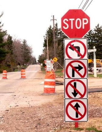 Road signs that point to no other way.